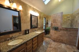 travertine bathroom designs saveemail suzie at home in arkansas tropical bathroom designs with travertine tiles and double granite sink