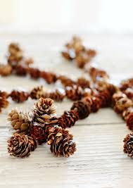 winter decorating pine cone snowflake thistlewood farm