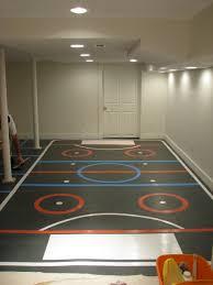 basement hockey rink with a sport court floor basement