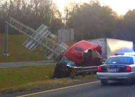 dallas semi truck driver crashes into alabama overhead interstate