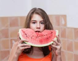 beautiful teen with slice of fresh watermelon young