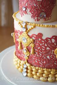 asian indian tall wedding cake lace henna red gold flowers 2