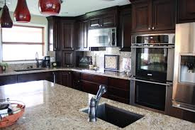 affordable custome cabinets showroom thumb kitchen western maple