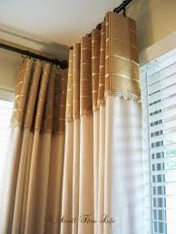Hang Curtains Higher Than Window by A Stroll Thru Life Tell Me Your Opinion How Do You Hang Drapes