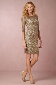gold lace sheath dress with sleeves for a wedding guest or mother