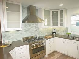 glass subway tile kitchen cylinder stainless fry pan concrete
