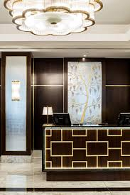 Hotel Lobby Reception Desk by Goddard Littlefair Transforms The Hilton Hotel Budapest Objekt