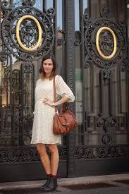 cream dresses black boots tan coats tawny bags brick red socks