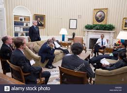 us president barack obama meets with senior advisors in the oval