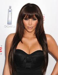 long dark brown haircut with long bangs for round face