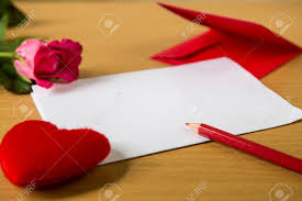 heart shaped writing paper red envelope with shape heart pillow on text love and rose sheet red envelope with shape heart pillow on text love and rose sheet of paper and