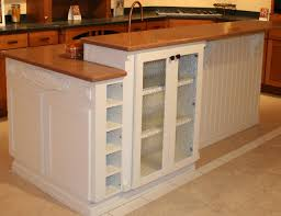 two level kitchen island with display space and wine storage the