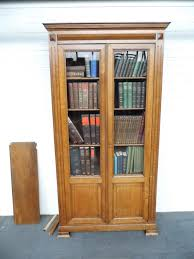 french oak bookcase with glazed doors and panelled doors 225976