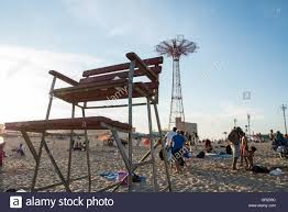 empty old wooden lifeguard chair on coney island beach with the