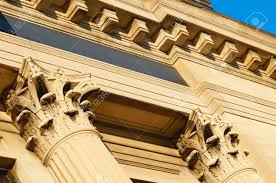 angled detail of corinthian style columns and cornice detail