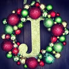 ornaments a styrofoam wreath a glue gun a wooden letter and