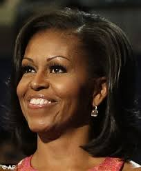 does michelle obama wear hair pieces michelle obama matches her nails to her tracy reese dress as she