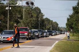 people wait hours for food assistance in wake of hurricane irma