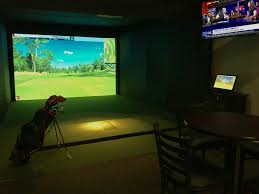 the indoor golf room at champions virtual golf