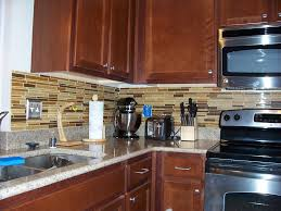 interior using peel and stick floor tile on kitchen walls