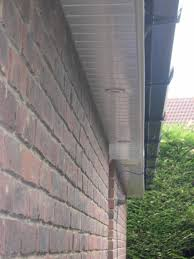 exterior brick wall with fiber chamfer and soffit lighting plus