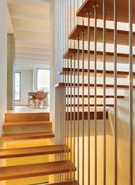 fancy stairs wall decor with metal floating steps in front of