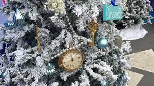 take a walk down the disney springs christmas tree trail theme