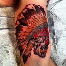 colorful skull in an indian headdress tattoo on arm tattoos book