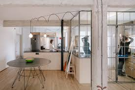 Glass Partition Between Living Room And Kitchen Smoke U0026 Mirrors This Small Apartment Doubles Its Visual Space