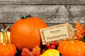 image happy thanksgiving autumn pumpkins with happy thanksgiving tag against a rustic