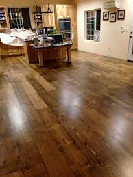 pine plank floors after rubbed stain and 2 coats of