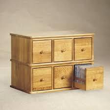 oak finish storage cabinet dvd cd cabinet leslie dame enterprises cd 150 dvd cd storage com