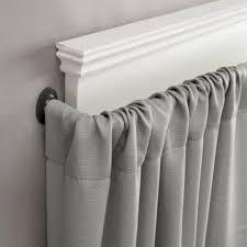 urban style interior decor with wrap around curtain rod at target