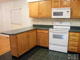 what color cabinets for white appliances kitchen transformation white cabinets painted counters