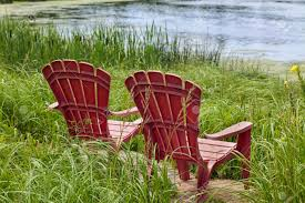 Colored Adirondack Chairs Red Plastic Adirondack Chairs Placed For A View Of The River