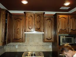 How To Resurface Kitchen Cabinets Yourself How To Stain Wood Cabinets In Kitchen