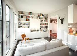 modern family room with hidden tv u0026 secretary desk contemporary