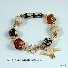 bead wire bracelet images Genuine amber and dzi bead wire wrapped bracelet with bird charm jpg