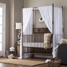 bronze polished iron crib with canopy and white curtain