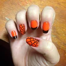 halloween nail art neon orange with black tips and a few spider