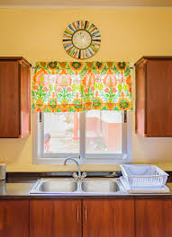 bethel house zambia building bethel full kitchen and cabinets colorful curtains to keep with the theme along with a clock above the windows