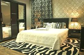 Zebra Area Rug Zebra Area Rugs In Master Bedroom With Patterned Wallpaper And Rug