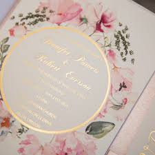 pink and gold glitter pocket wedding invitations with flowers in