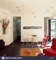 Narrow Living Room And Kitchen A Modern Dining Area With A Circular Table And Chairs Next To A