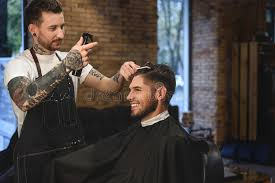tattooed hair stylist working with a guy stock photo image 78472542