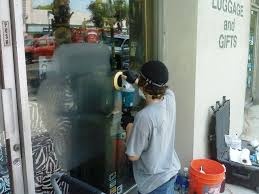 los angeles window green cleaning glass graffiti scratch removal
