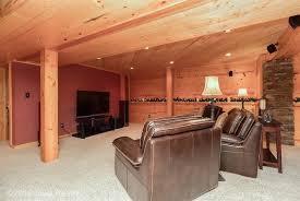 rustic basement with columns u0026 carpet in west des moines ia
