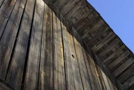 how to age wood paneling for that gray rustic look home guides