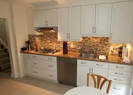 kitchen backsplash white cabinets brown countertop