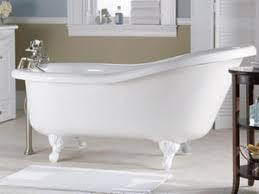 white clawfoot soaking tub with stainless steel mixer faucet on